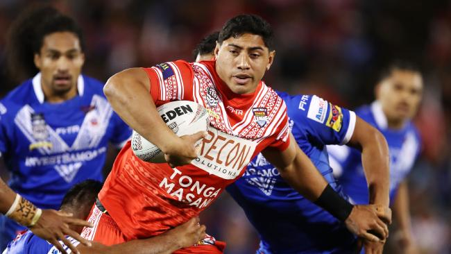 SYDNEY, AUSTRALIA — JUNE 23: Jason Taumalolo of Tonga is tackled by the Samoan defence during the 2018 Pacific Test Invitational match between Tonga and Samoa at Campbelltown Sports Stadium on June 23, 2018 in Sydney, Australia. (Photo by Brendon Thorne/Getty Images)