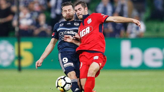 Kosta Barbarouses of the Victory and Ben Garuccio of Adelaide United in April. Picture: Getty Images