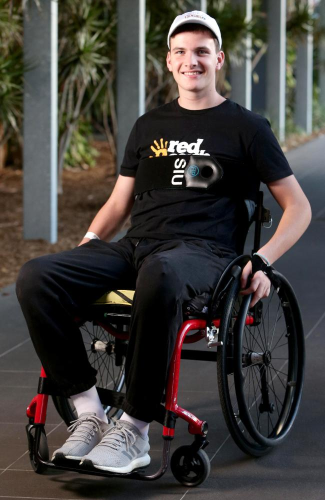 Conor Tweedy on first outing outside hopsital with wheelchair rugby guy, posing at PCYC Bowen Hills Brisbane - (AAP/Image Steve Pohlner)