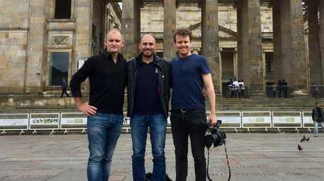 Dateline reporter Evan Williams, Manuel Bolivar and producer Will Reid in Bolivar square in central Bogota, the historical centre of Bogotá.
