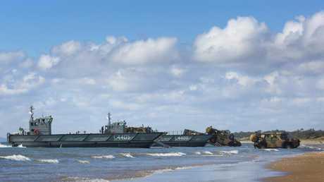 Royal Australian Navy landing craft unload during an exercise.