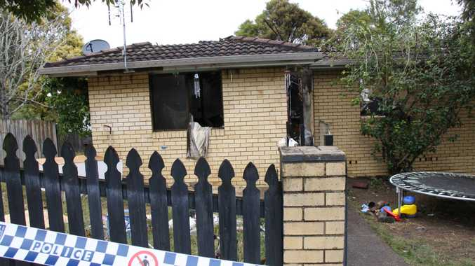 SUSPICIOUS FIRE: Police forensic officers sift through the scene of house fire in Goonellabah which has been deemed suspicious.