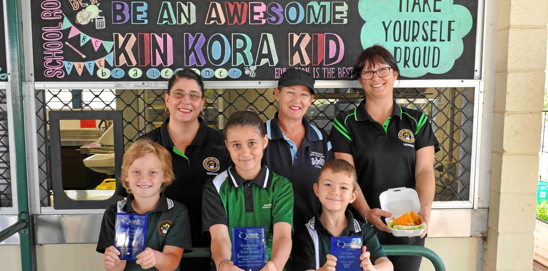 HEALTHY EATING: Students (L-R) Hayden Casey, Alyssa Raw, and Rylan Mooney with some of the team behind the success of Kin Kora State School's award-winning tuckshop - convenor Brenda Raw, volunteer Donella Waters and assistant convenor Claire Hammond.