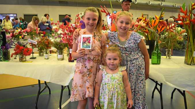 POCKETFUL OF POSIE: Finley, Liliana and Harmony Hepburn are just as sweet as the flowers at the Proserpine Flower Show.