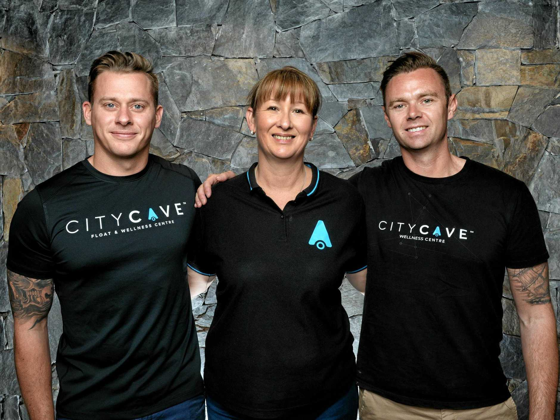 City Cave Ipswich owner Kathy Rees (middle) and City Cave founders Jeremy Hassell and Tim Butters.