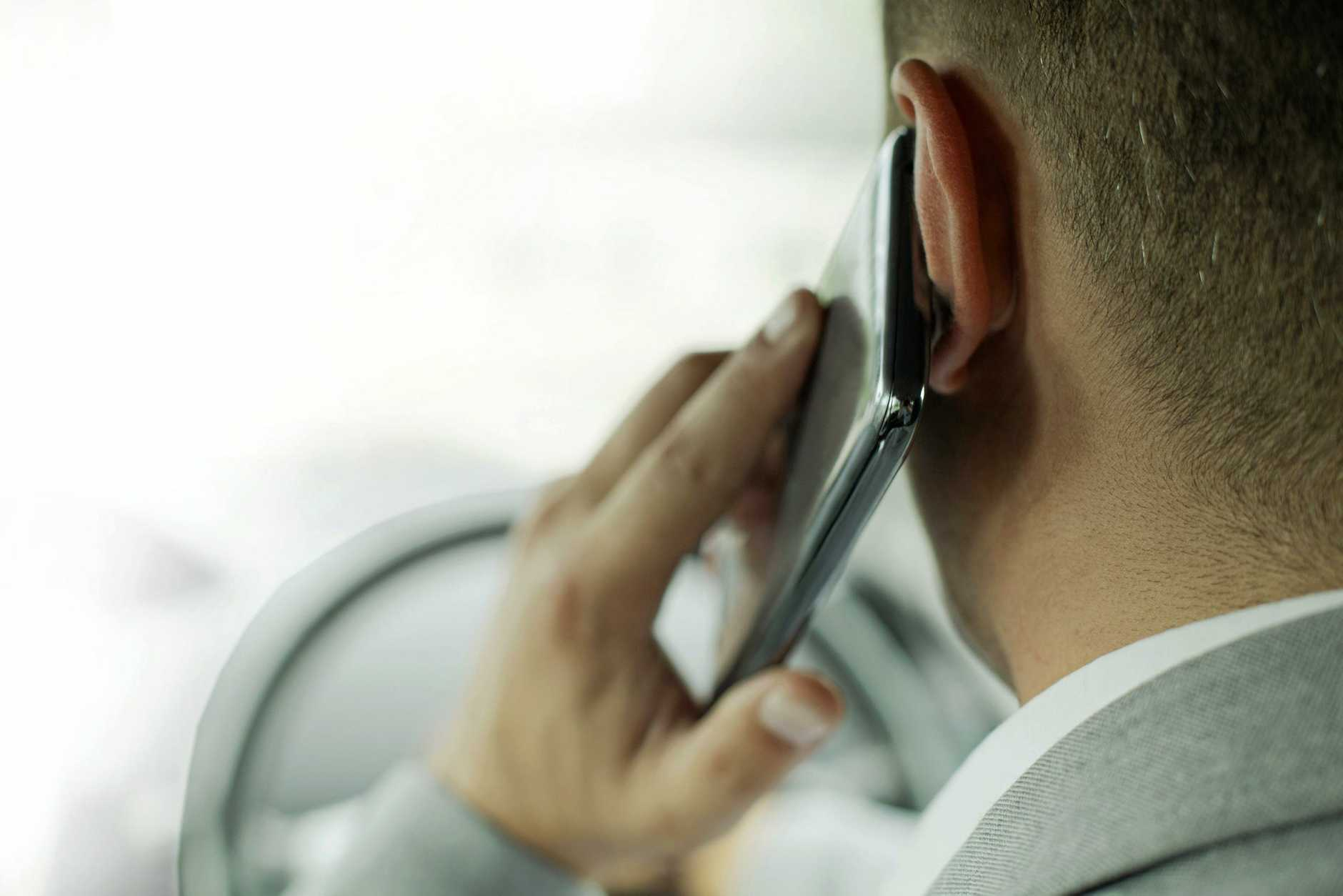BUSTED: 23 people were fined $337 for using mobile phones while driving in the Tweed yesterday.