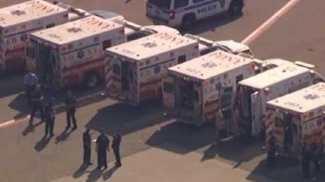 A row of ambulances wait for the sick people on the Emirates flight.  Picture:  Twitter