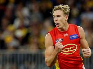 Footy divided over star's defection