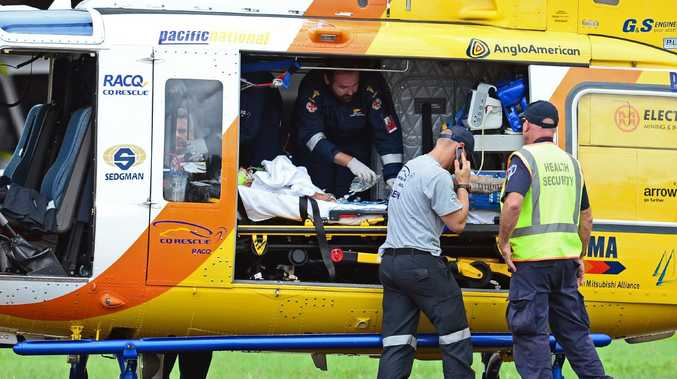 A chopper carrying a nine-month-old girl and an elderly woman arrives in Townsville after the buggy crash.