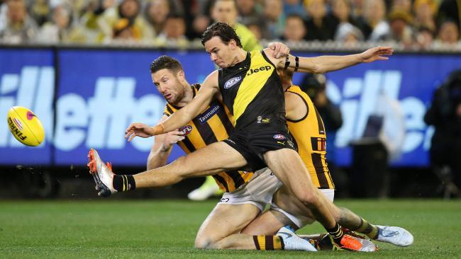 Daniel Rioli kicks a goal under pressure. Picture: Michael Klein