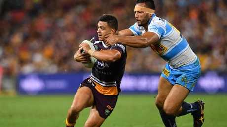 Kodi Nikorima is tackled by the Ryan James in the Broncos' round-four clash with the Titans at Suncorp Stadium. Photo: AAP