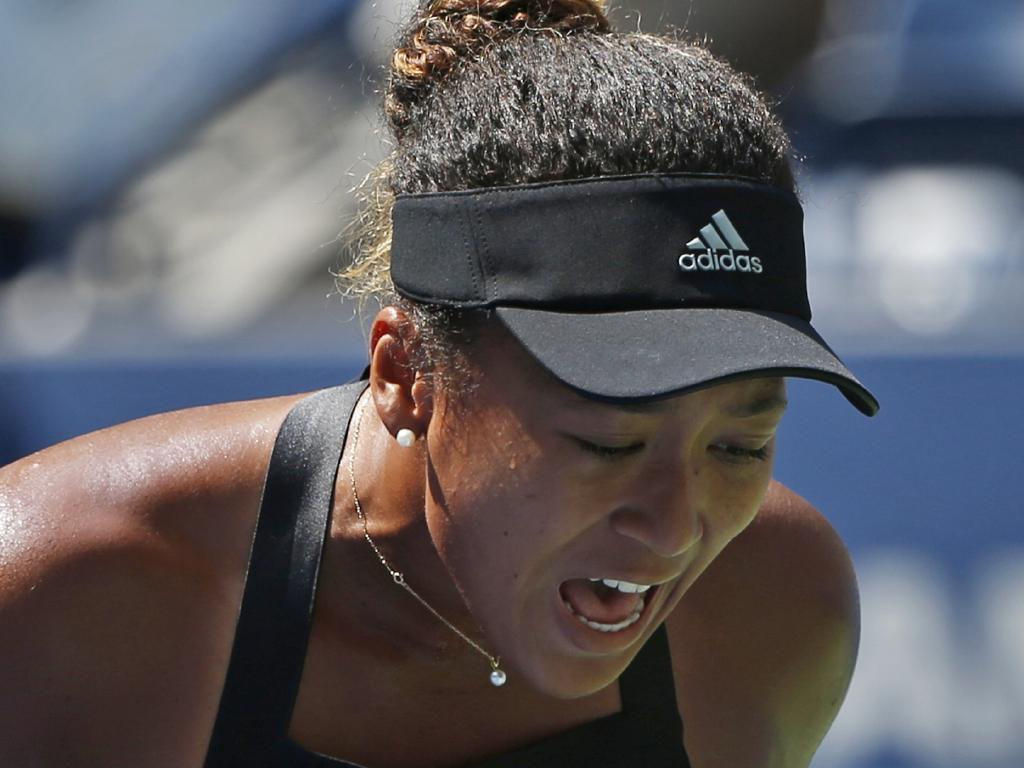 Naomi Osaka, of Japan, reacts after winning a point against Lesia Tsurenko. Picture: AP