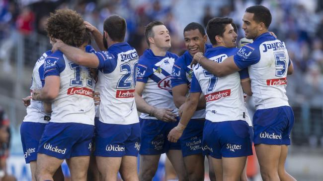 Bulldogs celebrate at full time during the Round 23 NRL match between the Canterbury-Bankstown Bulldogs and the Warriors at ANZ Stadium in Sydney, Sunday, August 19, 2018. (AAP Image/Craig Golding) NO ARCHIVING, EDITORIAL USE ONLY