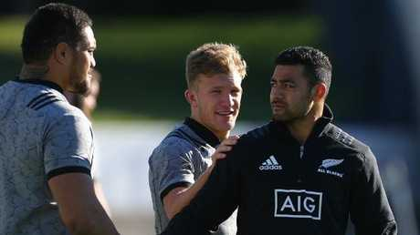 Richie Mo'unga is congratulated by Ofa Tuungafasi and Damian McKenzie at training.