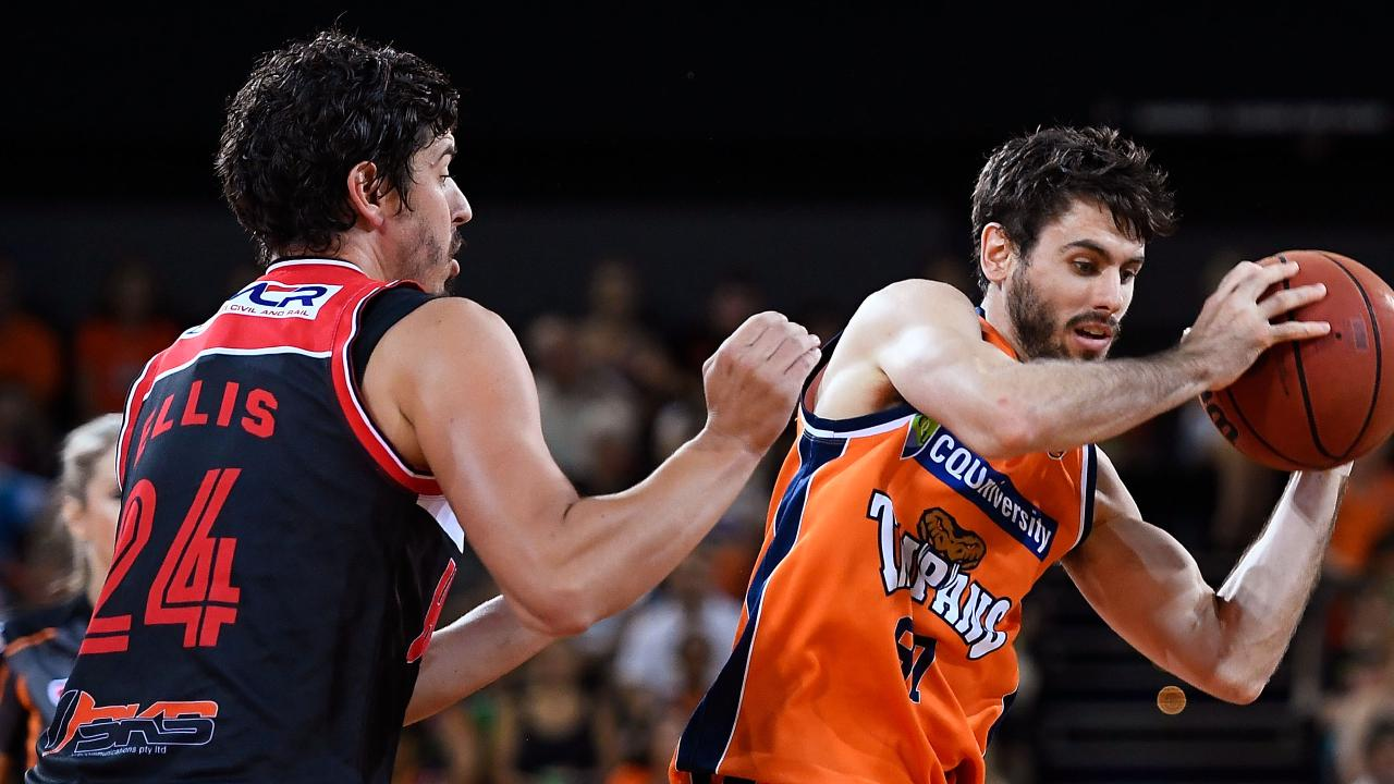 CAIRNS, AUSTRALIA — JANUARY 22: Jarrad Weeks of the Taipans looks to pass the ball past Cody Ellis of the Hawks during the round 16 NBL match between the Cairns Taipans and the Illawarra Hawks on January 22, 2017 in Cairns, Australia. (Photo by Ian Hitchcock/Getty Images)