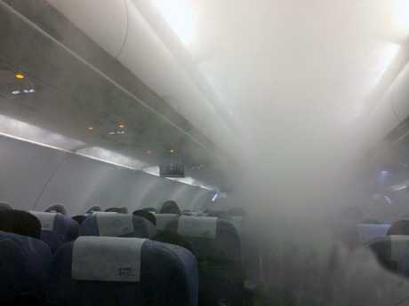 This is smog inside a plane, not smoke, but still it would be hard to see.