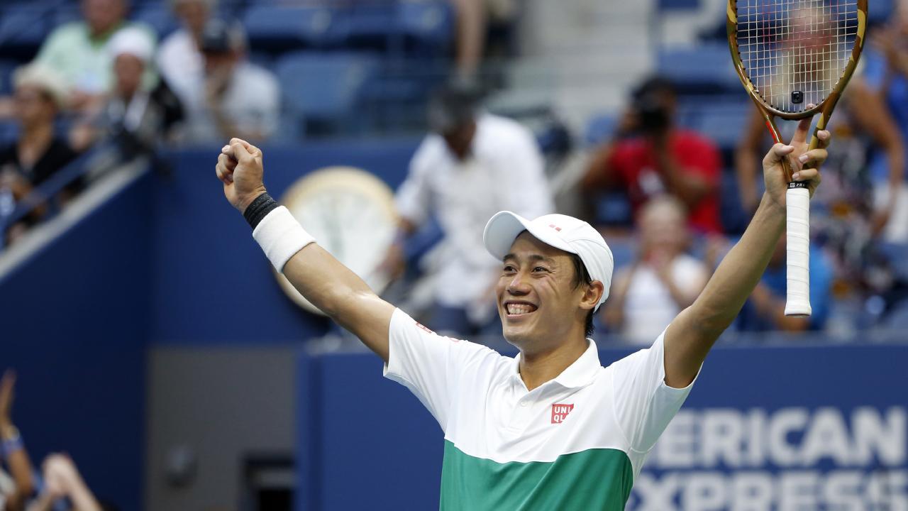 Japan's Kei Nishikori celebrates after defeating Marin Cilic. Picture: AP