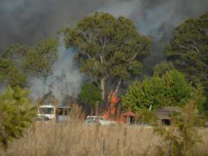 Roads close as fire rages near Wooroolin homes