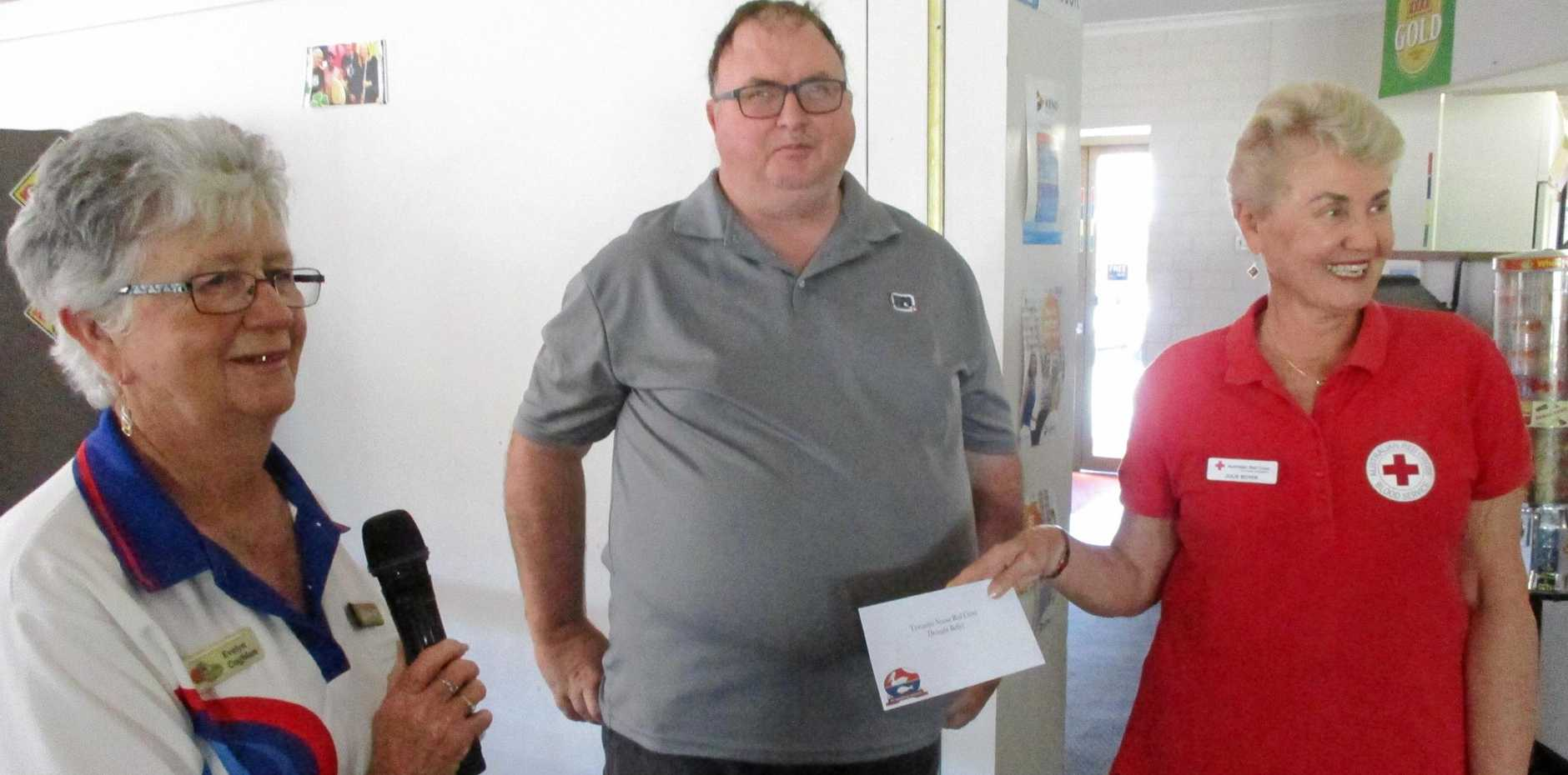 OPEN HEARTS: Tewantin Noosa Bowls Club presented a $1000 cheque for the Red Cross.