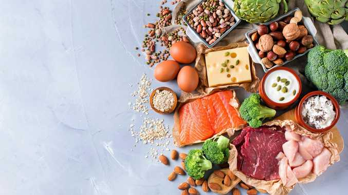 Assortment of healthy protein source and body building food. Meat, beef, salmon, chicken, breast, eggs, dairy products, cheese, yogurt, beans, artichokes, broccoli, nuts and oat meal.
