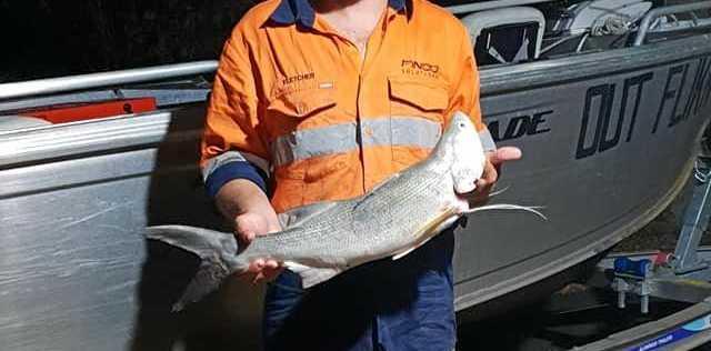 Fletcher Harrington with a threadfin salmon.