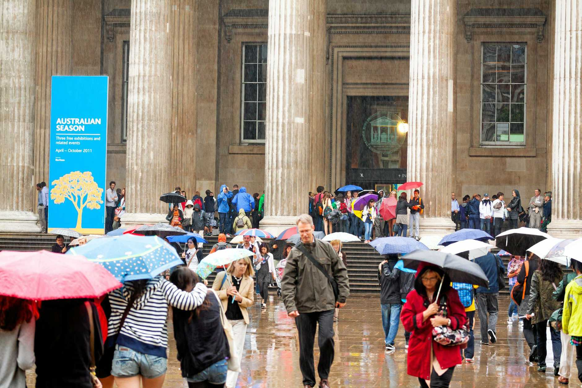 Tourists flock to the British Museum on a rainy day.