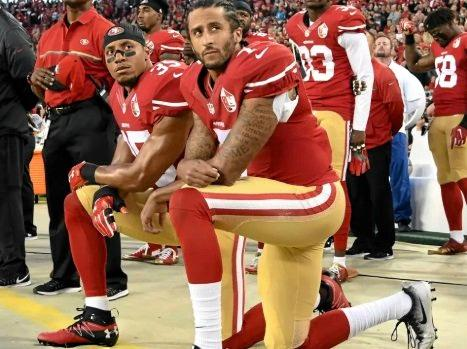 The decision by Colin Kaepernick, right, to kneel in protest against police violence has cost him his NFL career.