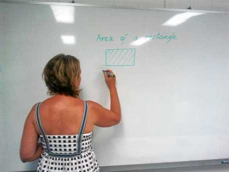A teacher draws on a whiteboard Photo John Parker / APN Online