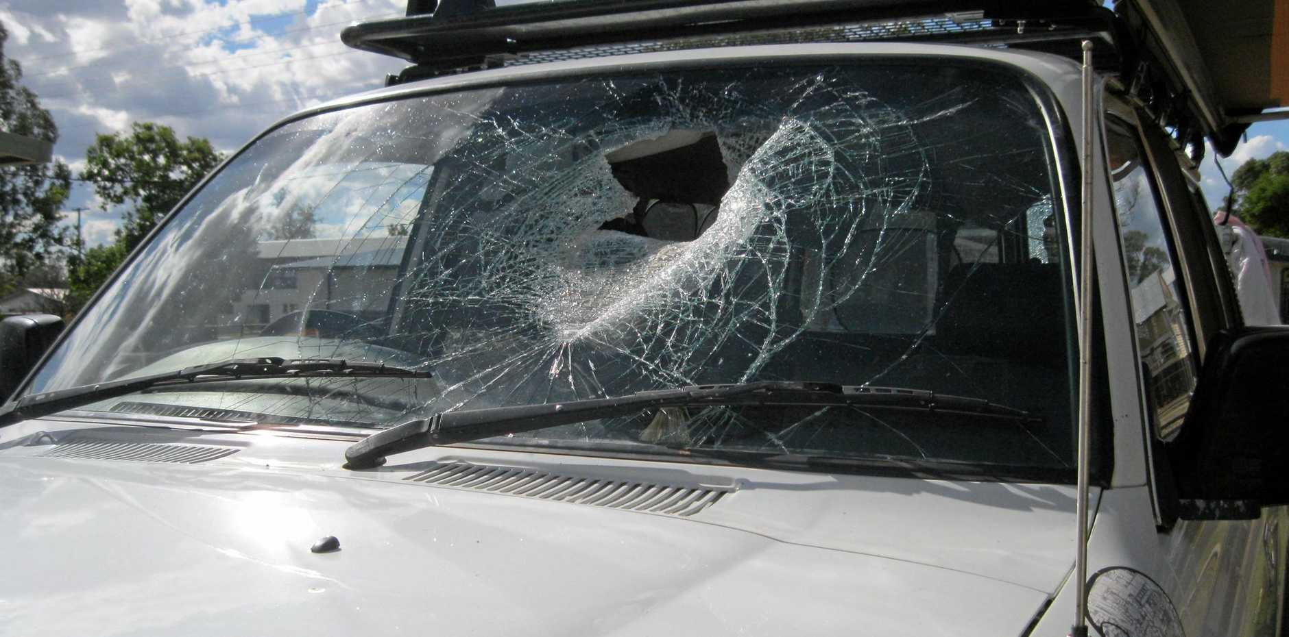 CLOSE CALL: A family was lucky to survive after a brick fell from an oncoming truck and smashed through two windscreens on the Warrego Highway near Miles on Thursday.