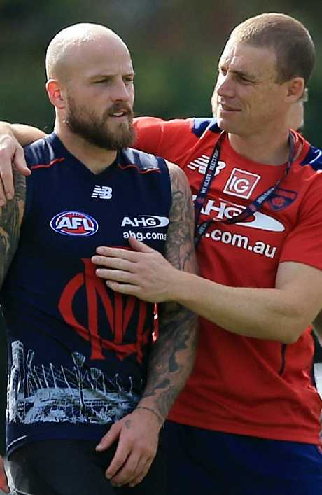 Simon Goodwin, right, pictured with co-captain Nathan Jones, has been described as a very personable coach who is big on building relationships with his players and staff. Picture: Wayne Ludbey