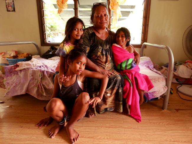 Local Rebecca Derandag with her grandchildren at her home on Nauru.