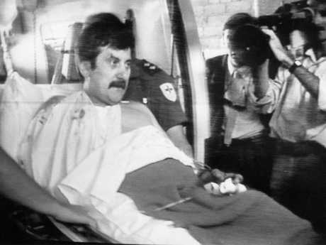 """Victoria Police Det-Sgt John Kapetanovski arrives at hospital after being shot and wounded by Noble Park gunman Pavel """"Mad Max"""" Marinof in 1986. Det-Sgt Kapetanovski's police partner Sgt Rod MacDonald shot and killed Marinof during the gunbattle which saw he and Det-Sgt Kapetanovski wounded."""