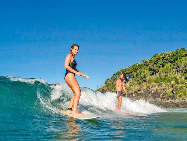 Bree Warren and her fiance Mitch McCann share a love of surfing. Picture: Supplied