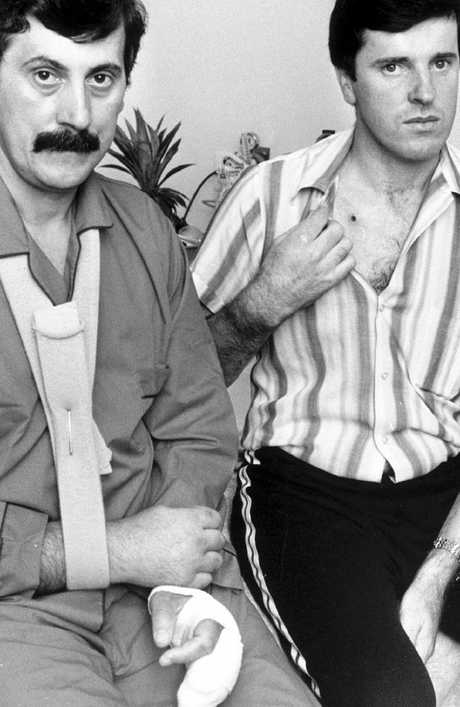 """Det-Sgt John Kapetanovski (left) and Sgt Rod MacDonald (right) pictured soon after they were both shot and wounded during a 1986 gunbattle with Noble Park gunman Pavel """"Mad Max"""" Marinof. Sgt MacDonald shot and killed Marinof after he and Det-Sgt Kapetanovski intercepted Marinof's vehicle on the Hume Highway at Kalkallo."""