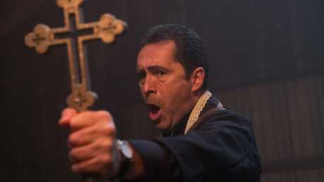 DEMIAN BICHIR as Father Burke in a scene from New Line Cinema's horror film