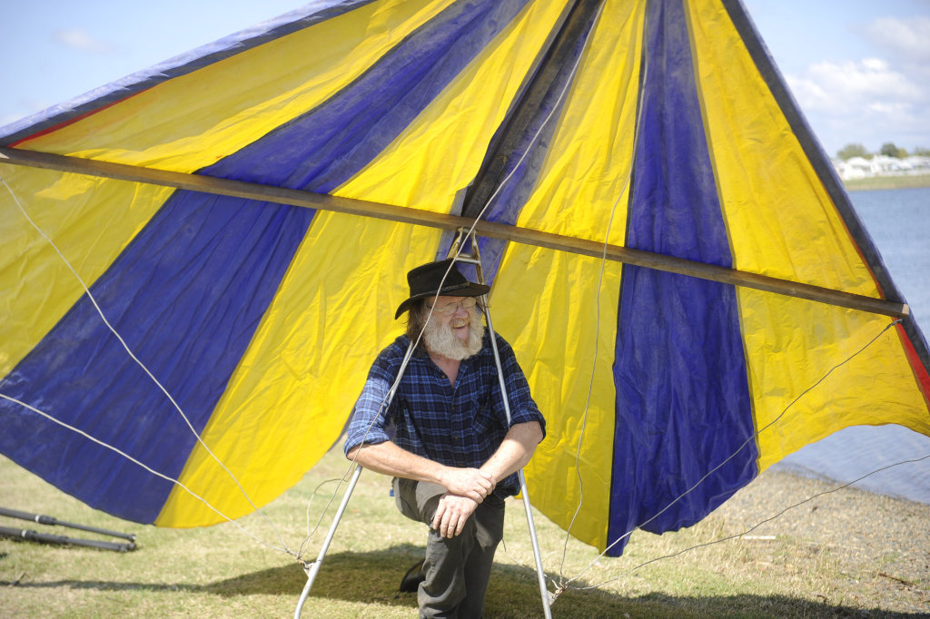 Image for sale: Graeme Henderson shows off the first hang glider.