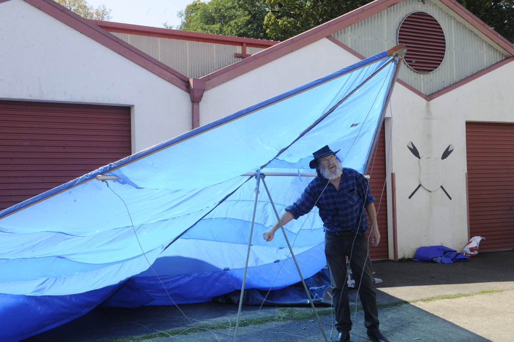 Image for sale: Graeme Henderson shows audiences a replica of the first prototype of the hang glider