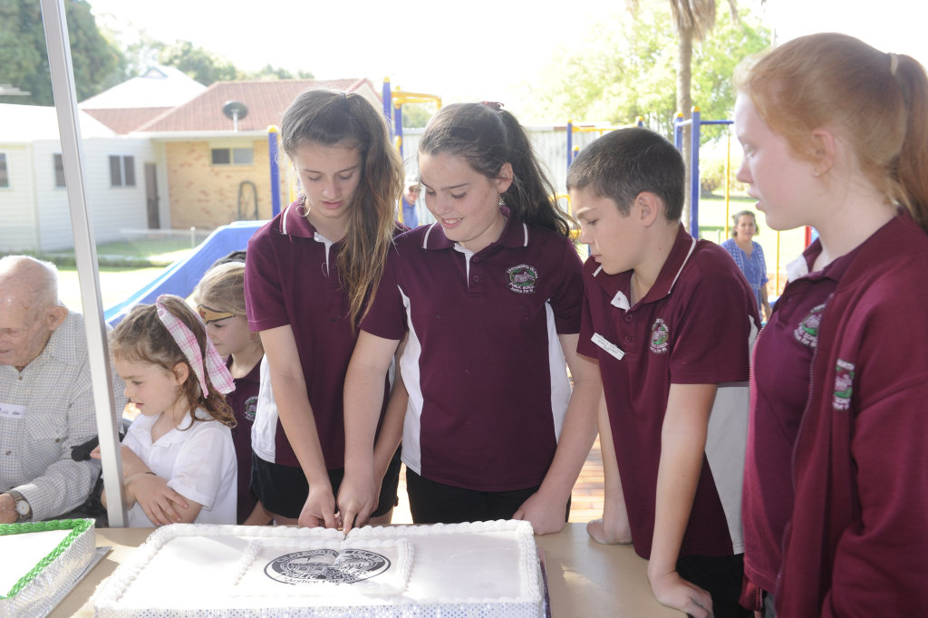 Image for sale: Year 6 students cut the cake at the celebration of the 150th anniversary of Chatsworth Island Public School.