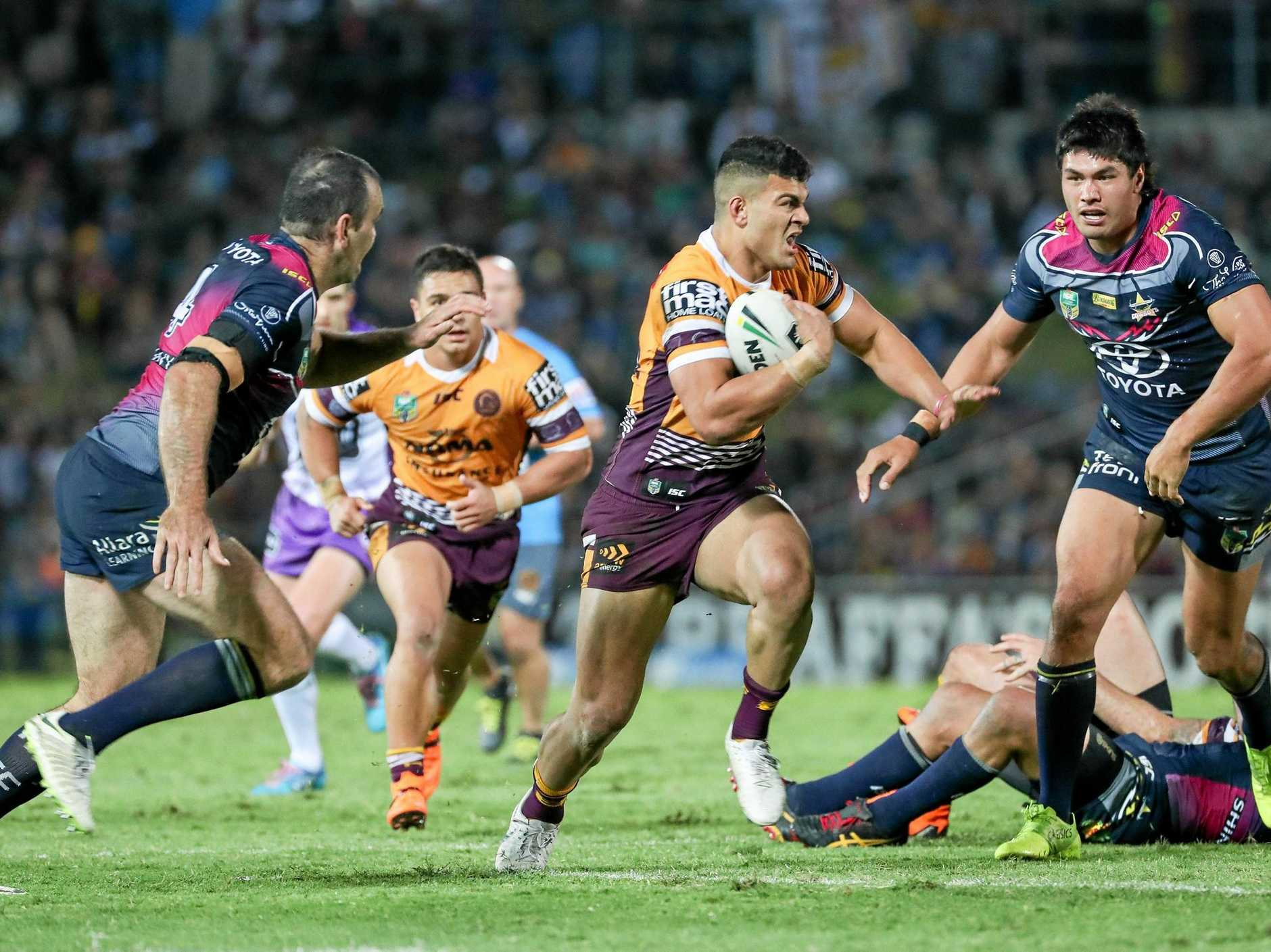 The Broncos' David Fifita looks for a gap in the Cowboys defence during their round 22 clash in Townsville. Picture: Michael Chambers/AAP