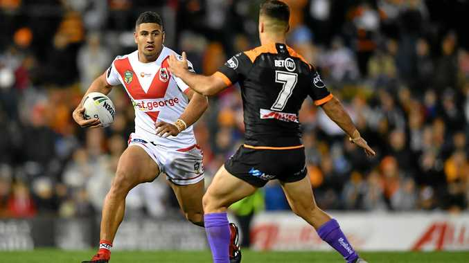 The Dragons' Nene Macdonald uses his pace to advantage against the Wests Tigers in round 23. Picture: Joel Carrett/AAP