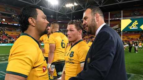 Kurtley Beale gets congratulated by Michael Cheika after the win. Picture: AAP.