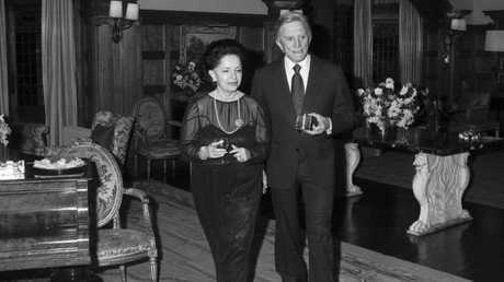 Lady Mary Fairfax and Kirk Douglas at a party given by the Fairfax family at the Fairwater estate in 1980. Picture: Keith Byron