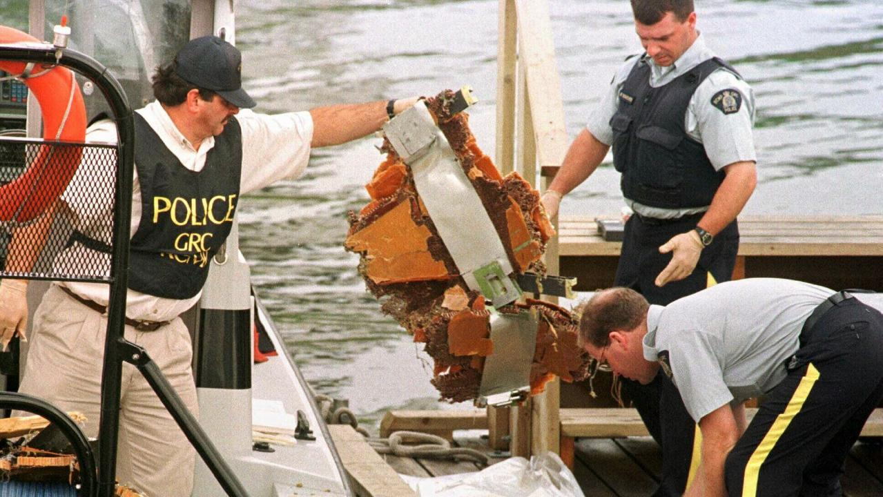 Canadian police sort through debris from the wreckage. Picture: AP