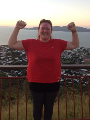 Angela Atkinson climbs to the top of Castle Hill, a walk that spurred her to eventually lose 45kg.