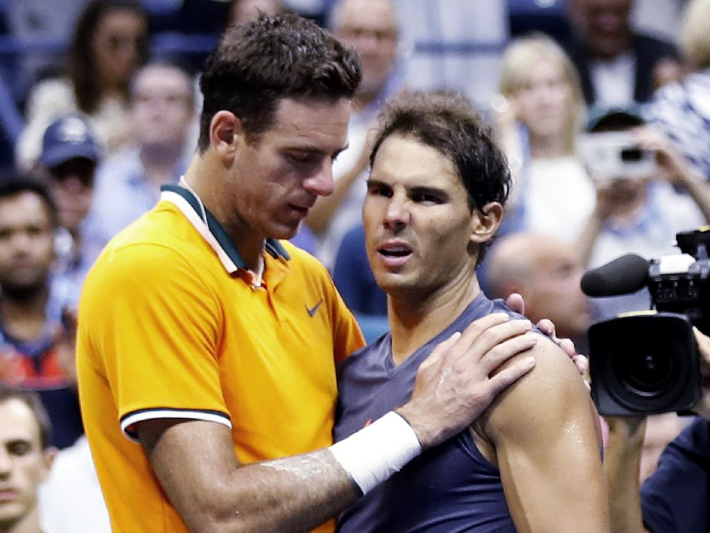 Juan Martin del Potro talks with Rafael Nadal after the match. (AP Photo/Adam Hunger)