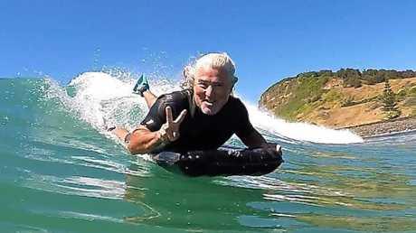 Mark Thompson with his hi-tech surf mat.