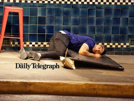 A Canterbury Bulldogs player laying on the ground after falling asleep during Mad Monday celebrations at the Harbour View Hotel at The Rocks. Picture: Christian Gilles