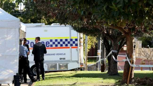 Police are seen at a property in Bedford where up to five bodies have been discovered. Picture: AAPSource:AAP