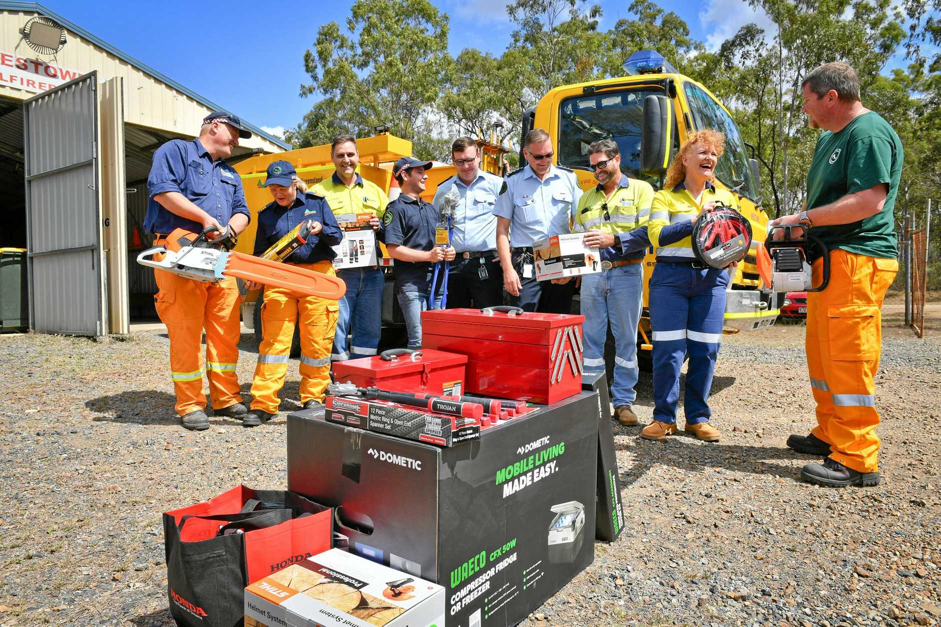 FIRIES SUPPORT: Orica employees and Yarwun fire-fighters going over donated equipment after Westowe Fire Station was broken into recently. Pictured are Danny Devers, Kerrie Darrach, Dewald Herman, Jamie Lea, Daniel Schneider, Craig Magick, Paul Shannon, Suzie Lane and Wayne Hoffman.