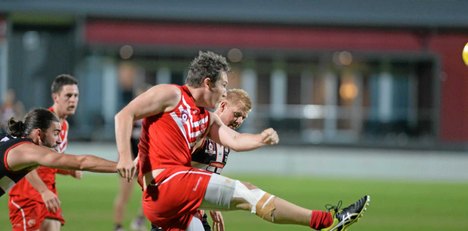 IN ACTION: Liam Porter from the Swans belted the ball up field before the Saints could close in for a tackle.